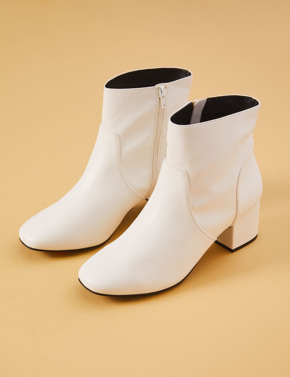 Vintage Boots, Granny Boots, Retro Boots Lane Bryant Womens White Faux Leather Ankle Boot 12W White $62.99 AT vintagedancer.com
