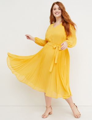 f24925b4dba3 A midi dress from the Beauticurve X Lane Bryant collection. Lightweight  woven chiffon fabric with a pleated skirt for volume and movement. V-neck.