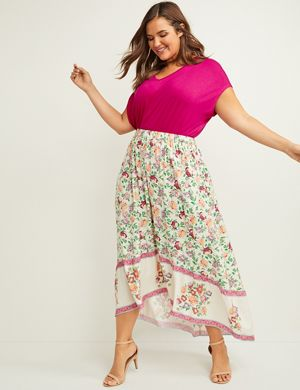 99e2e9f0ce A floral maxi skirt in lightweight woven fabric with a contrasting border  at the high-low hem. Pull-on styling with a covered elastic waistband.