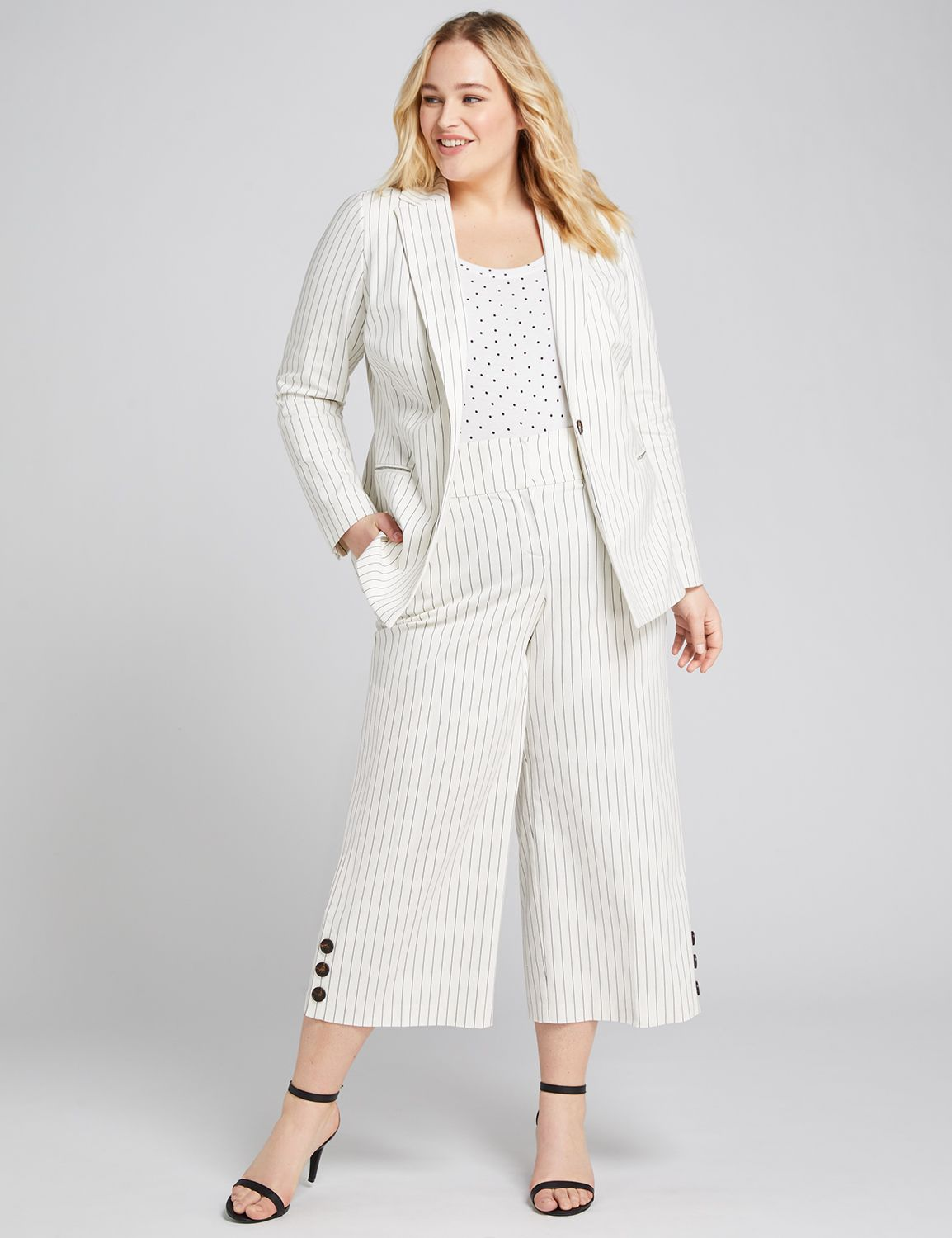 high-rise pants features a no-gap waist construction with slimming Power Pockets to secretly smooth your tummy. Stay cool in these crops with a wide-leg silhouette and a polished pinstripe print. The super-chic button detail at the hem adds the perfect style bonus. Belt loops. Four pockets. Zip fly. Double bar & slide closure with inner button.